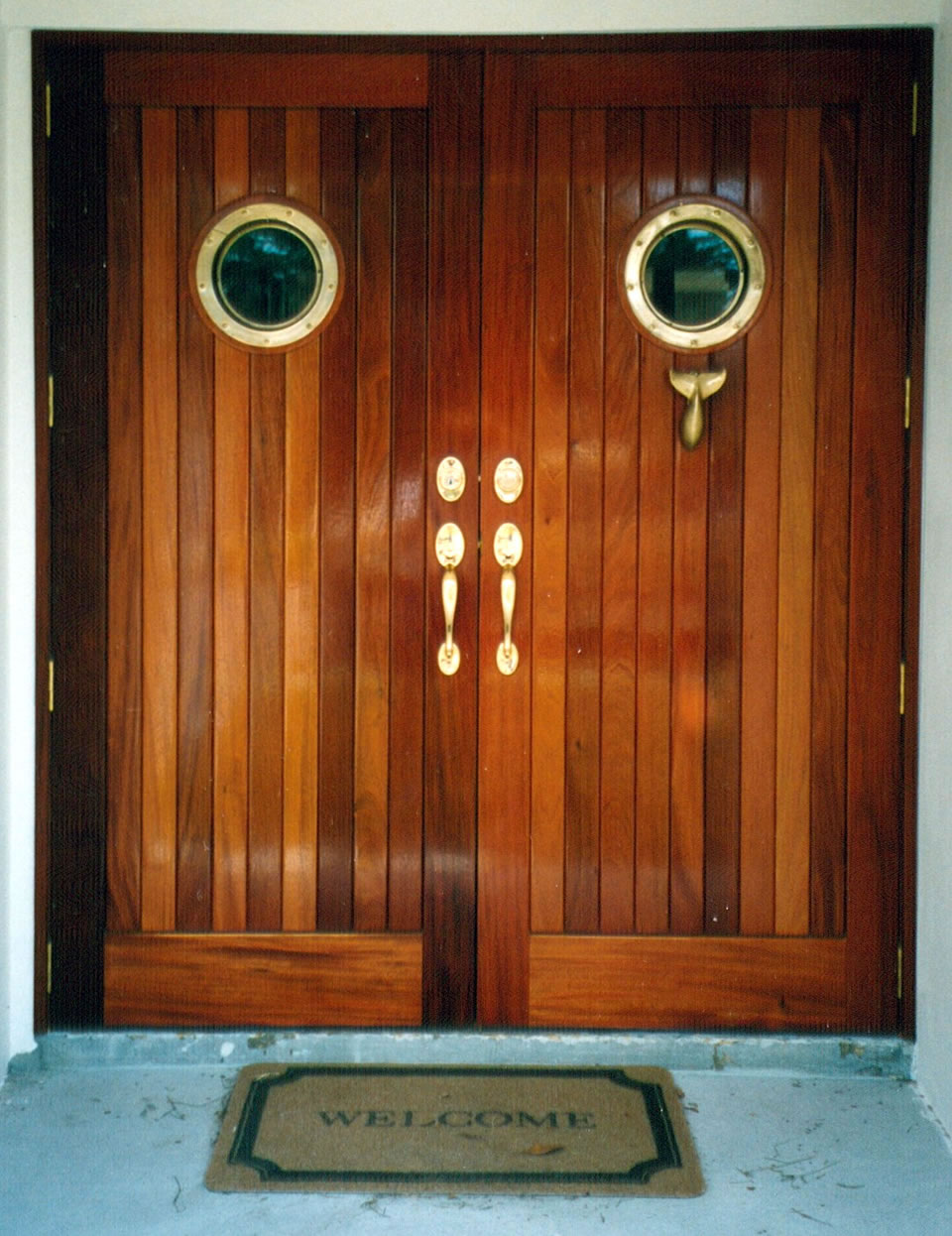 Natural designs inc tampa florida for Small double front doors